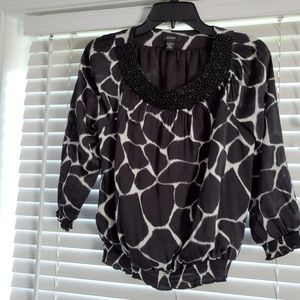 Alfani blouse is size 2